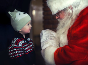 Little girl giving Santa her Christmas list