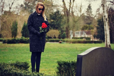 Woman at Grave side of suicide