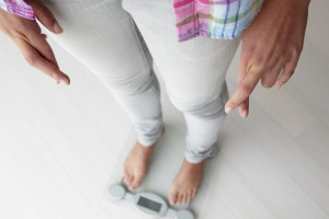 Close up detail girl weighing herself